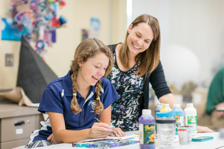 Keswick Christian School_Academic_Student Painting with teacher
